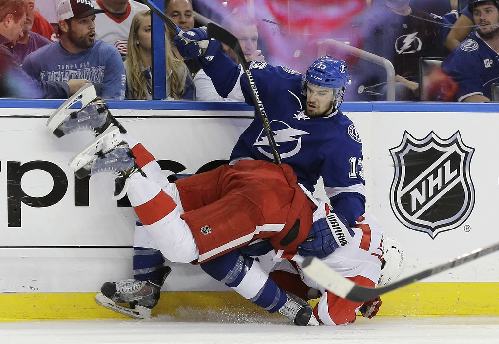 . Detroit Red Wings defenseman Danny DeKeyser (65) and Tampa Bay Lightning center Cedric Paquette (13) collide during the second period of Game 7 of a first-round NHL Stanley Cup hockey playoff series Wednesday, April 29, 2015, in Tampa, Fla. (AP Photo/Chris O\'Meara)