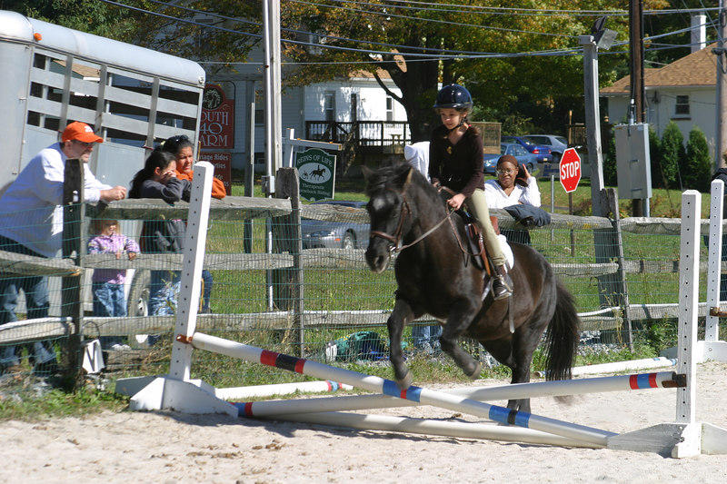 Anisa and Bridget jumping over the cross rails.  Anisa took 2nd place and Nina was third.