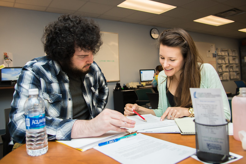 Student tutor Mary Luttrell(right) helps student Andrew B. in the writing center.