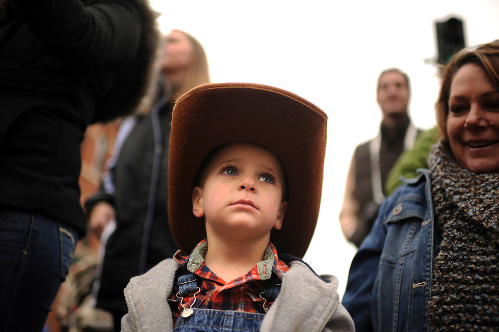 . Dalton Ferree, 2, of Littleton is watching 107th National Western Stock Show Kick-Off Parade at Downtown Denver on Thursday, Denver, CO, January 10, 2013.  Hyoung Chang, The Denver Post