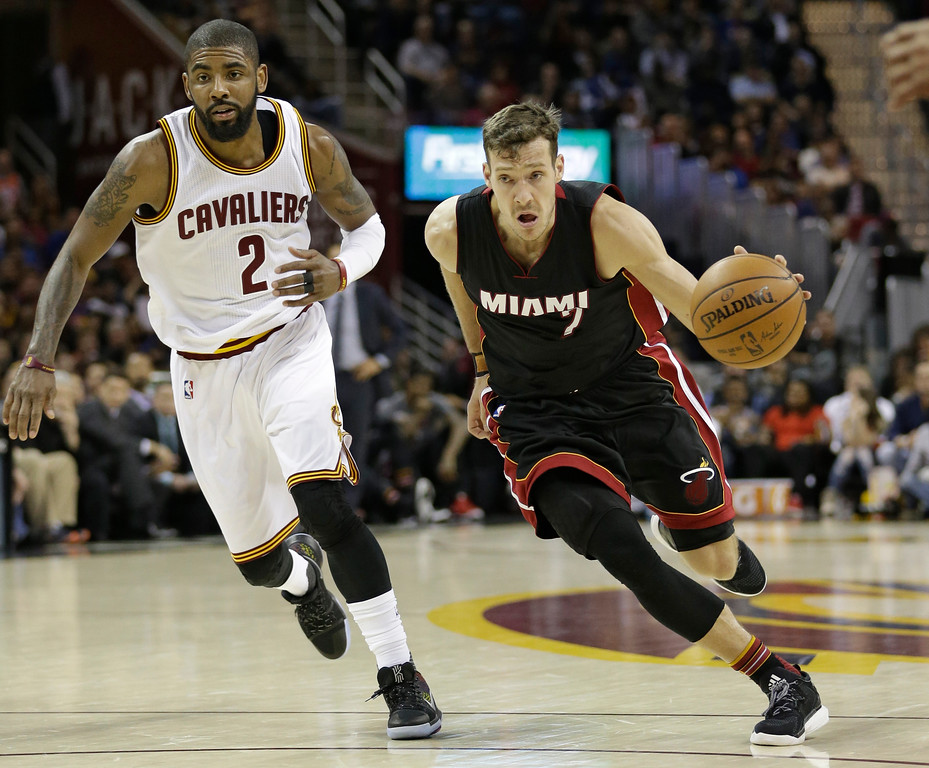 . Miami Heat\'s Goran Dragic (7), from Slovenia, drives against Cleveland Cavaliers\' Kyrie Irving (2) in the second half of an NBA basketball game, Monday, March 6, 2017, in Cleveland. (AP Photo/Tony Dejak)