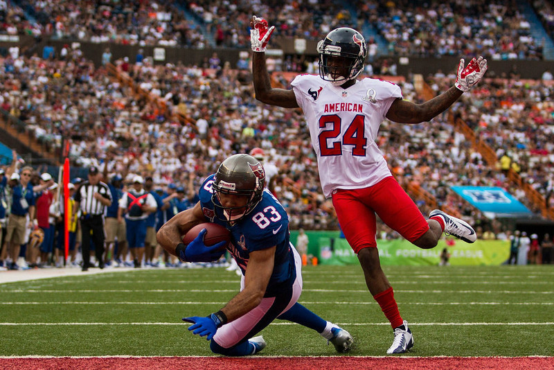 . Vincent Jackson #83 of the NFC\'s Tampa Bay scores a touchdown after catching a pass over Johnathan Joseph #24 of the AFC\'s Houston Texans during the 2013 AFC-NFC Pro Bowl on January 27 , 2013 at Aloha Stadium in Honolulu, Hawaii.  (Photo by Kent Nishimura/Getty Images)