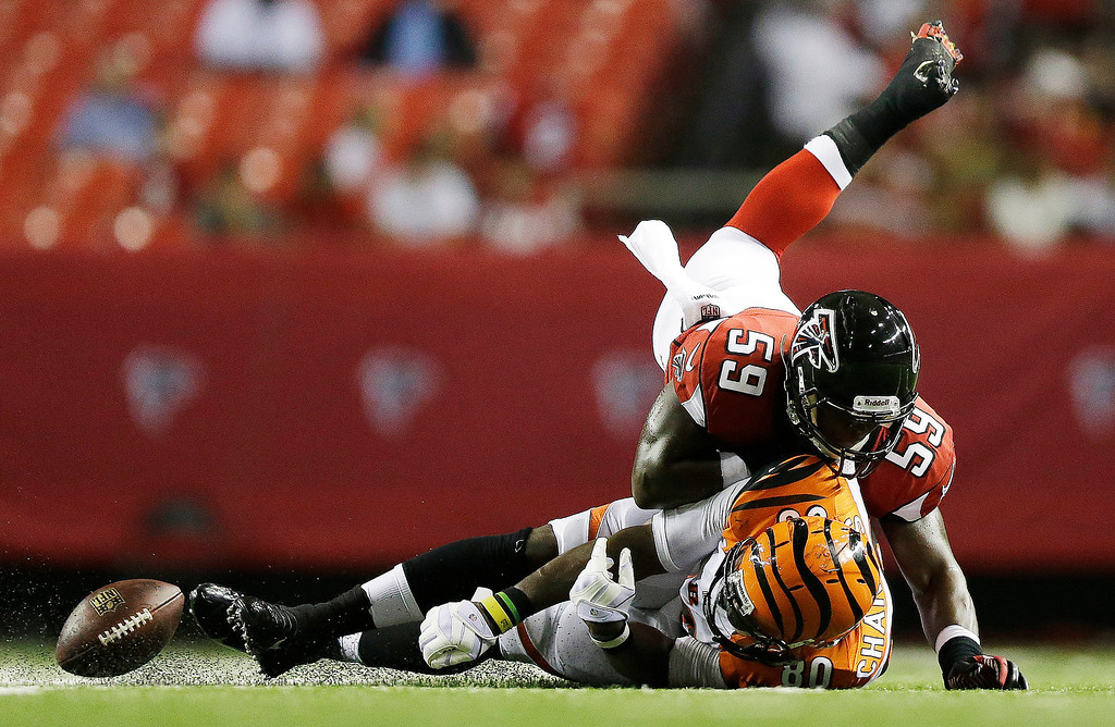 . Atlanta Falcons linebacker Joplo Bartu (59) tackles Cincinnati Bengals tight end Orson Charles (80) during the first half of a preseason NFL football game, Thursday, Aug. 8, 2013, in Atlanta.  (AP Photo/David Goldman)
