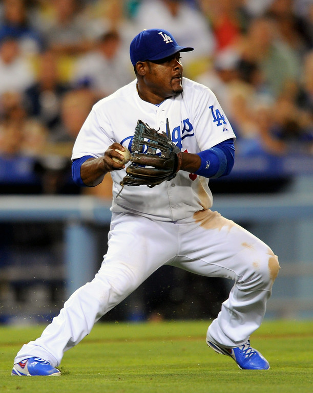 . Dodgers third baseman Juan Uribe fields a grounder by the Padres Jesse Hahn and throws late to second base in the sixth inning, Friday, July 11, 2014, at Dodger Stadium. (Photo by Michael Owen Baker/Los Angeles Daily News)