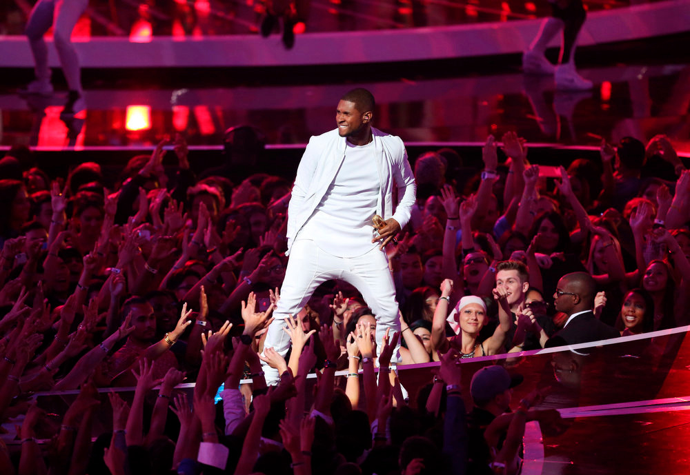 . Usher performs at the MTV Video Music Awards at The Forum on Sunday, Aug. 24, 2014, in Inglewood, Calif. (Photo by Matt Sayles/Invision/AP)