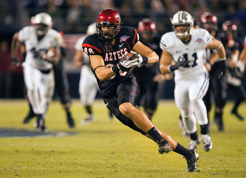 . Gavin Escobar #88 of the San Diego State Aztecs runs with the ball in the first half of the game against the BYU Cougars in the Poinsettia Bowl at Qualcomm Stadium on December 20, 2012 in San Diego, California. (Photo by Kent C. Horner/Getty Images)