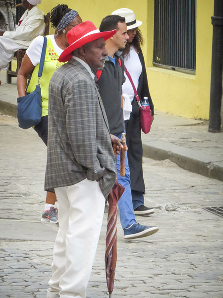 Many gentlemen are attired and ready for 'paid' photos with tourists.