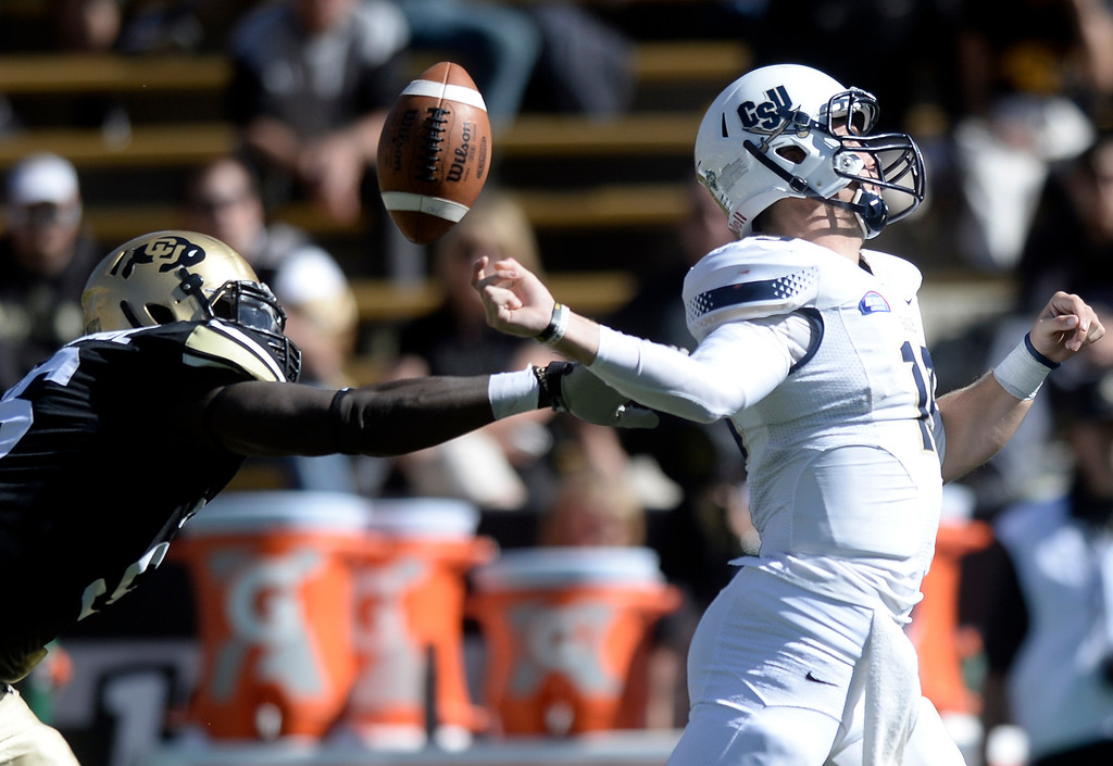 . University of Colorado\'s Chidera Uzo-Diribe knocks the ball out of the hands of quarterback Kyle Copeland during a game against Charleston Southern on Saturday, Oct. 19, at Folsom Field in Boulder.  (Jeremy Papasso/Boulder Daily Camera)