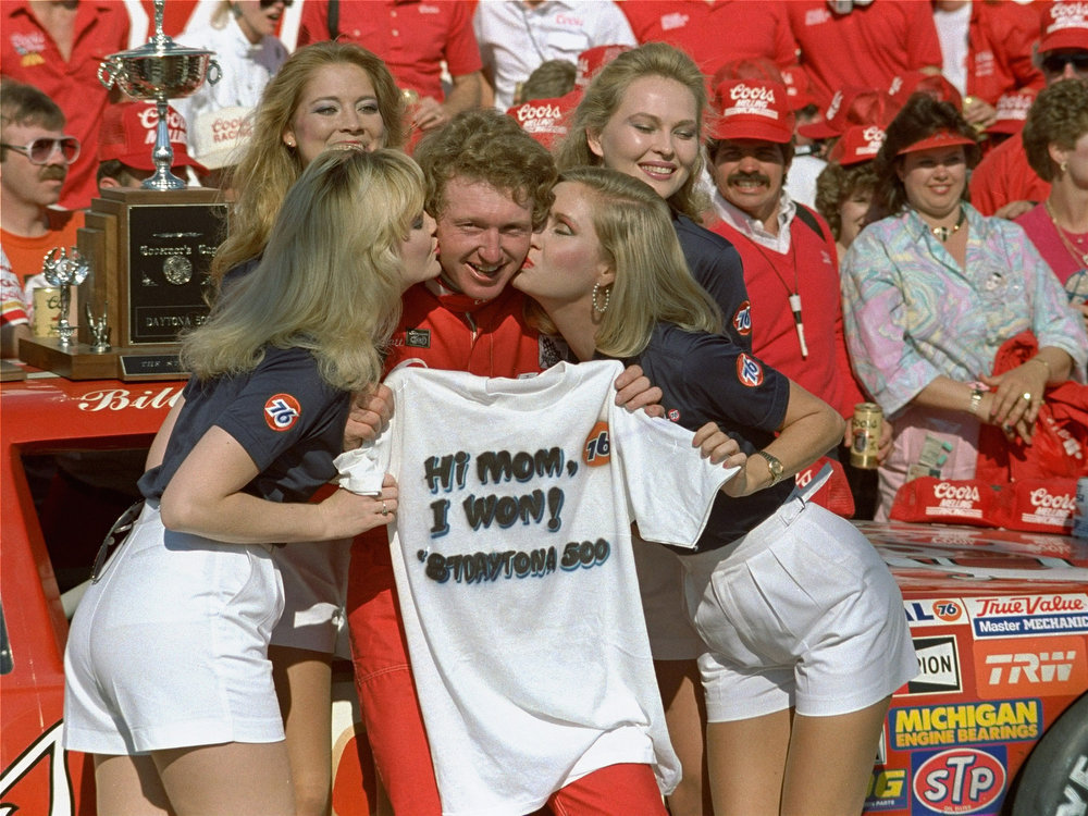 Description of . Bill Elliott, from Dawsonville, Ga., gets a victor\'s reward in Victory Lane here February 15, 1987 after winning the Daytona 500 auto race.  (AP Photo/Walt Chernokal)
