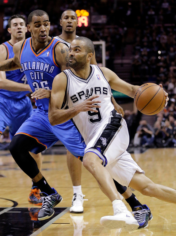 . San Antonio Spurs\' Tony Parker (9), of France, drives around Oklahoma City Thunder\'s Thabo Sefolosha (25) during the first half of Game 1 of a Western Conference finals NBA basketball playoff series, Monday, May 19, 2014, in San Antonio. (AP Photo/Eric Gay)
