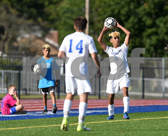 09/08/17 Wesley Bunnell   Staff Plainville Boys Soccer defeated visiting Bristol Eastern on Friday afternoon. Plainvilles Mike Torres (6) inbounds the ball.