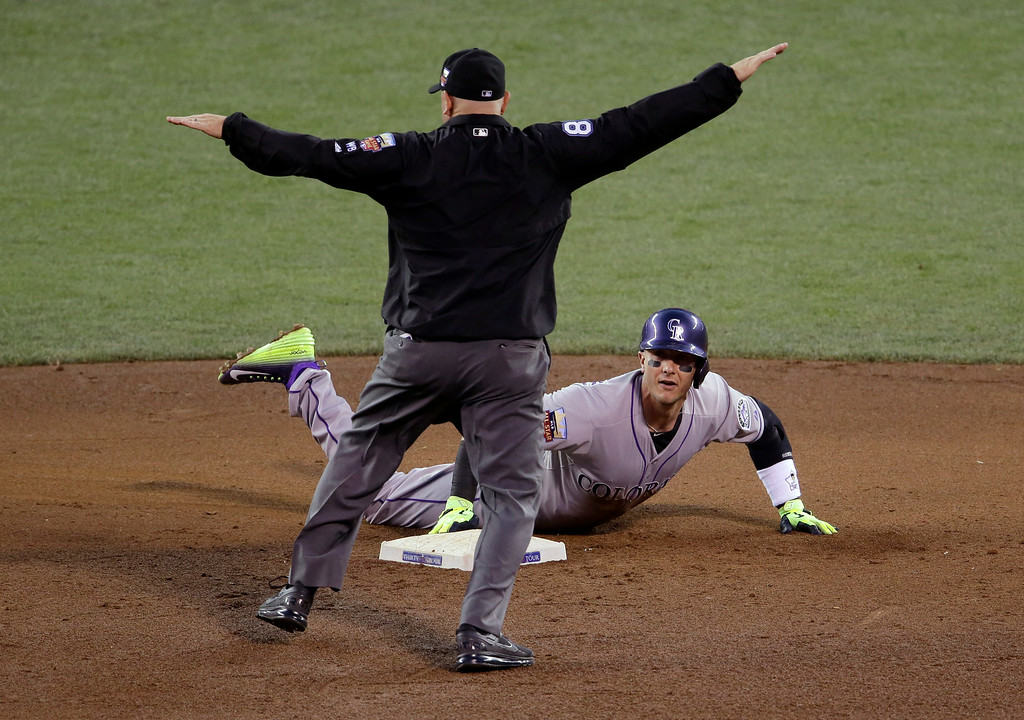 . National League\'s Troy Tulowitzki, of the Colorado Rockies, slides safely into second base during a fifth inning double in the MLB All-Star baseball game, Tuesday, July 15, 2014, in Minneapolis. (AP Photo/Paul Sancya)