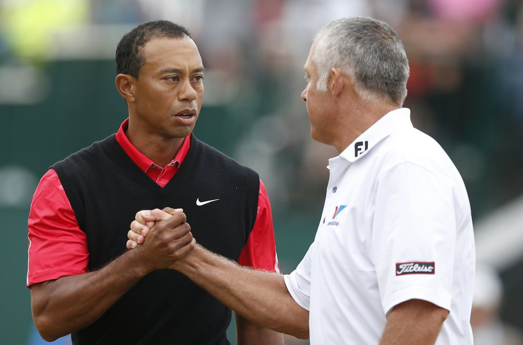 ". <p><b><a href=\'http://www.latimes.com/sports/sportsnow/la-sp-sn-tiger-woods-steve-williams-british-open-20130722,0,1774780.story\' target=""_blank\""> Tiger Woods and former caddie Steve Williams shook hands after the final round of the British Open on Sunday. It�s their warmest exchange in the two years since Tiger ... </a></b> <p> <b>A. Fired Williams </b> <p><b> B. Slept with Williams� wife </b> <p> <b>C. Slept with Williams� wife, then fired Williams</b> <p> --------------------------------------------   (AP Photo/Matt Dunham)  <br> <p><b>ANSWERS</b> <p> The correct answer is always \""A\"" ... unless you feel very strongly otherwise. <p> <p>Follow Kevin Cusick on <a href=\'http://twitter.com/theloopnow\'>twitter.com/theloopnow</a>."