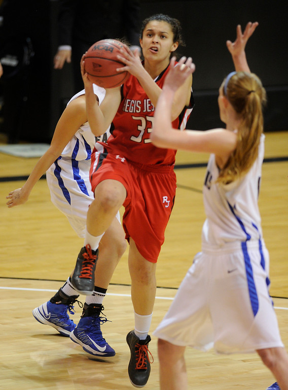 . BOULDER, CO. - MARCH 16: Raiders sophomore guard Jessica Lewis (33) drove to the basket in the first half. The Regis Jesuit High School girl\'s basketball team took on Highlands Ranch in the 5A championship game Saturday, March 16, 2013 at the Coors Events Center in Boulder.  (Photo By Karl Gehring/The Denver Post)