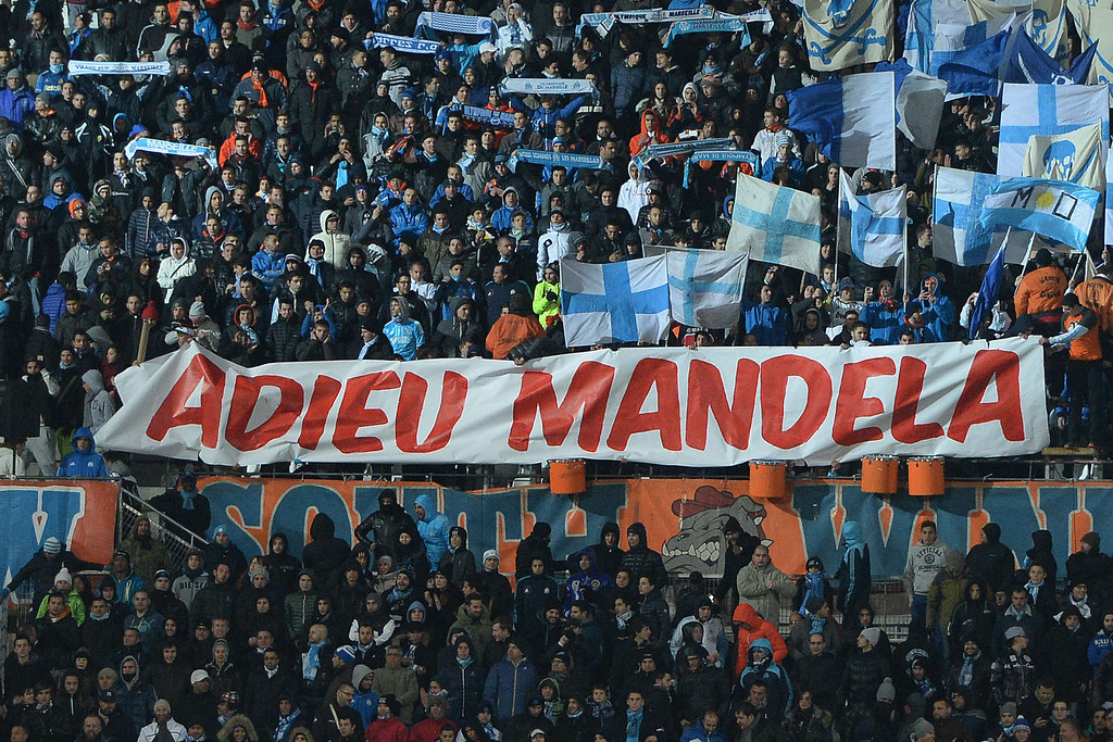 """. Marseille\'s football club supporters hold a banner reading \""""Farewell Mandela\"""" before the start of the French L1 football match Olympique of Marseille (OM) versus Nantes (FCNA) at the Velodrome stadium in Marseille, southern France, on December 06, 2013, a day after the death of former South African President Nelson Mandela.  AFP PHOTO / BORIS HORVAT/AFP/Getty Images"""