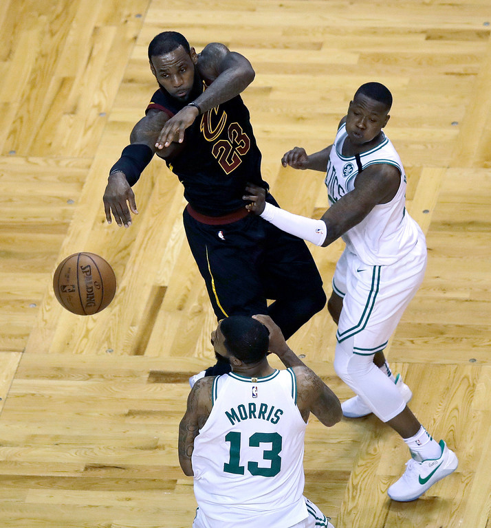 . Cleveland Cavaliers forward LeBron James (23) passes the ball as Boston Celtics forward Marcus Morris (13) and guard Terry Rozier, right, defend during the first half in Game 7 of the NBA basketball Eastern Conference finals, Sunday, May 27, 2018, in Boston. (AP Photo/Charles Krupa)