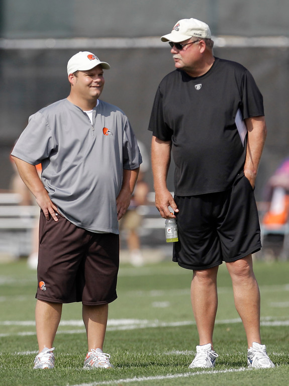 . Cleveland Browns general manager Tom Heckert, left, talks with president Mike Holmgren during practice at the NFL football team\'s training camp Monday, Aug. 1, 2011, in Berea, Ohio. (AP Photo/Tony Dejak)