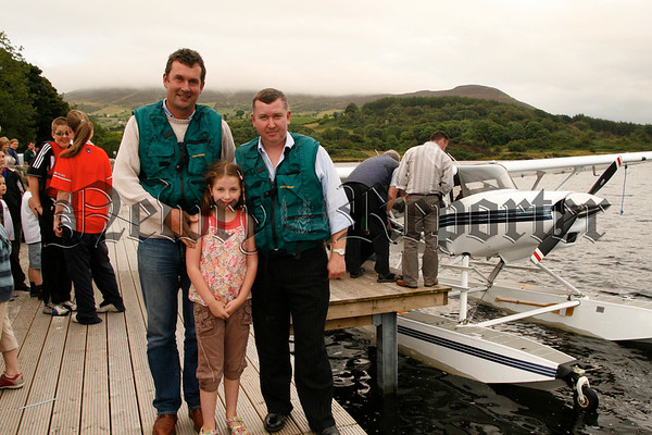 History makers Nial Kearney (left,pilot) and Aidan & Aine Rice who landed their Seaplane on Camlough Lake, Interested  spectators gathered to view the plane before it took of for Fermanagh, 07W33N55