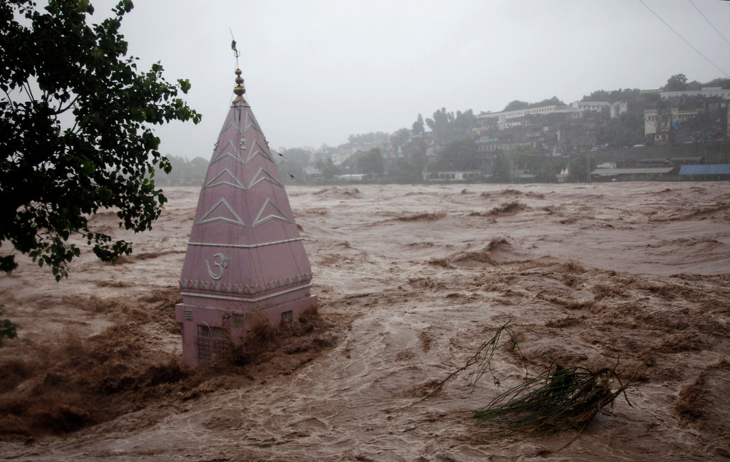 . A temple is partially submerged in floodwaters in Jammu, India, Saturday, Sept. 6, 2014. Heavy monsoon rains have caused flash floods and landslides. The flooding began earlier this month in Kashmir, where it has caused landslides and submerged much of the main city of Srinagar, on the Indian-administered side.  (AP Photo/Channi Anand)