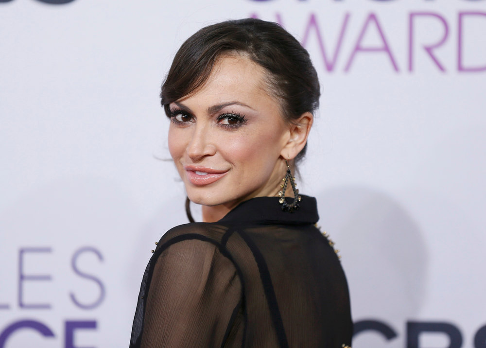 ". Dancer Karina Smirnoff, of the series ""Dancing With the Stars,\"" poses as she arrives at the 2013 People\'s Choice Awards in Los Angeles, January 9, 2013.   REUTERS/Danny Moloshok"