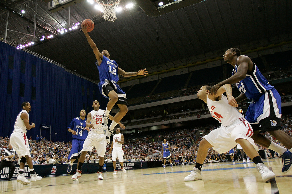 . Memphis guard Antonio Anderson soars to the basket through a thin Ohio State defense during their NCAA South Regional final basketball game at the Alamodome in San Antonio Saturday, March 24, 2007.  (AP Photo/David J. Phillip)
