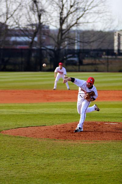 Pitcher, Andrew Barnett, throws a ball