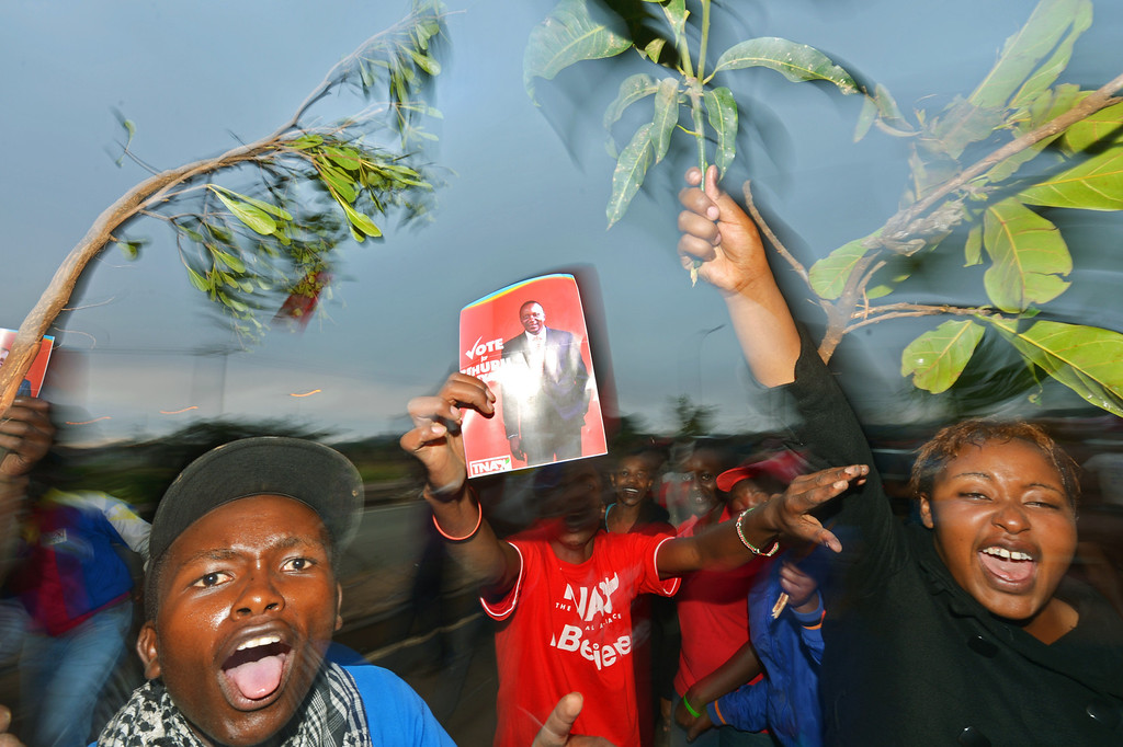 . Supporters of presidential candidate Uhuru Kenyatta celebrate as they hear of his victory in Kenya\'s national elections in Nairobi on March 9, 2013.  AFP PHOTO/ Carl  DE SOUZA/AFP/Getty Images