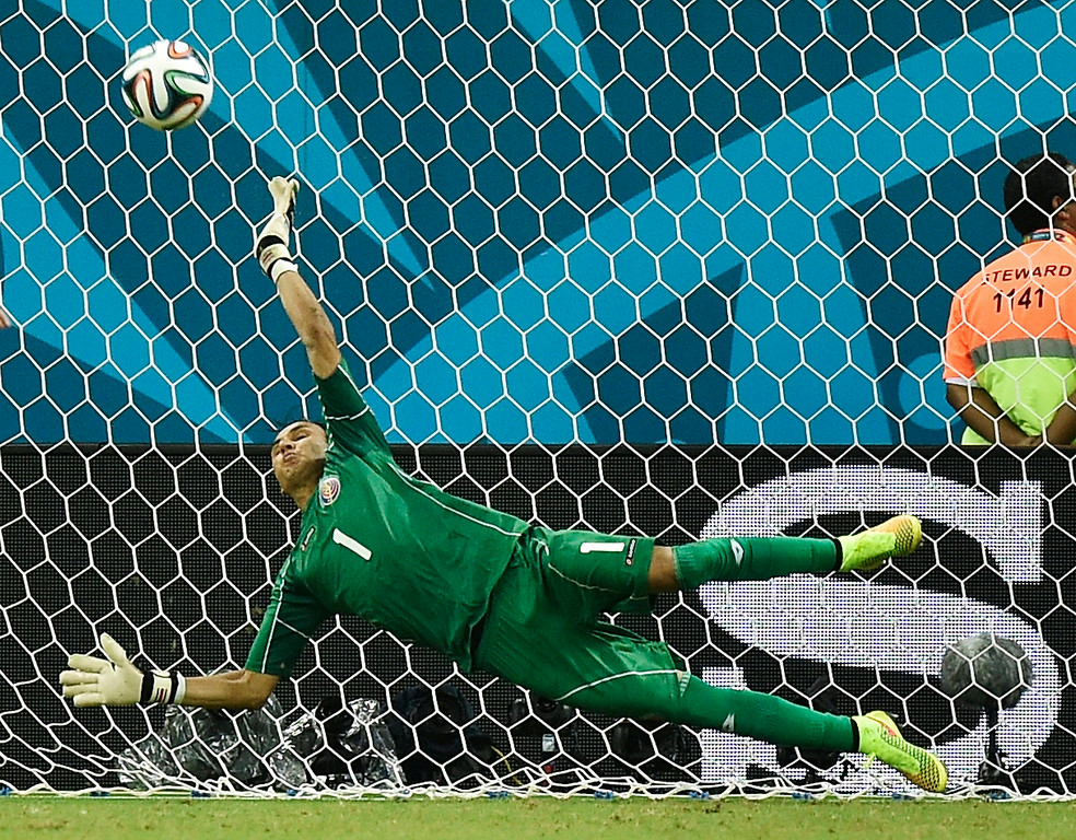 . Costa Rica\'s goalkeeper Keylor Navas makes a save on Greece\'s Fanis Gekas penalty shot during a shootout after regulation time in the World Cup round of 16 soccer match between Costa Rica and Greece at the Arena Pernambuco in Recife, Brazil, Sunday, June 29, 2014. Costa Rica defeated Greece 5-3 in penalty shootouts after a 1-1 tie. (AP Photo/Martin Meissner)