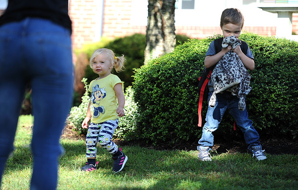 8/29/2019 Mike Orazzi | Staff Blair Sansoucie photographs her children Caroline and Caellum at Derynoski Elementary School on Southington's first day back this year.