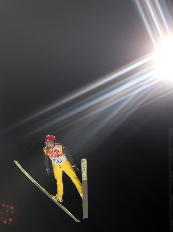 . Simon Ammann of Switzerland in action during a trial jump in RusSki Gorki Jumping Center at the Sochi 2014 Olympic Games, Krasnaya Polyana, Russia, 14 February 2014.  EPA/GRZEGORZ MOMOT
