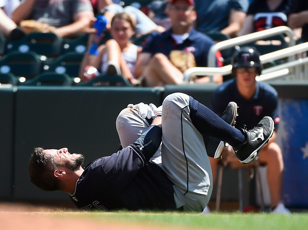 . Cleveland Indians Yan Gomes is injured after being tagged out by Minnesota Twins first baseman Kennys Vargas during the fifth inning of a baseball game Sunday, July 17, 2016, in Minneapolis. Gomes had to leave the game. (AP Photo/Craig Lassig)