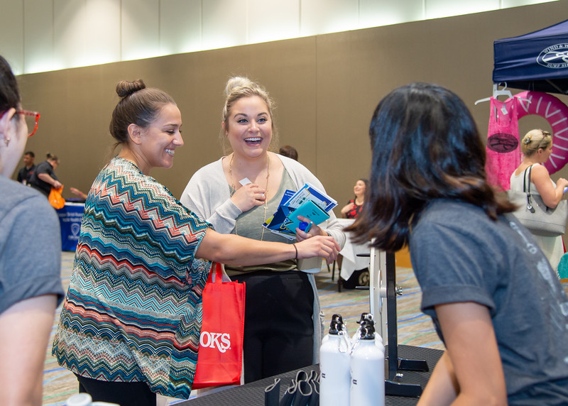 Brittney Weise (center) wins a BOGO coupon for gelato from Coffee Waves during the Corpus Christi Community Fair.