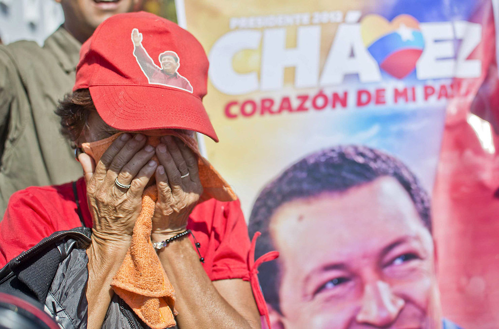 ". A supporter of the late President Hugo Chavez weeps outside of his funeral in Caracas, on March 8, 2013. Late Venezuelan president Hugo Chavez will be moved to a barracks where he will lie in state for longer than had been planned, then be embalmed ""like Lenin\"". AFP PHOTO/Ronaldo SchemidtRonaldo Schemidt/AFP/Getty Images"