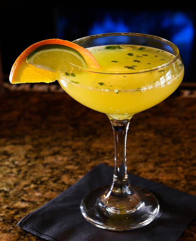 """. DENVER, CO - APRIL 21: A  \""""Desperado\"""" cocktail with Milagro, pineapple, cucumber lime syrup,  cilantro and habanero at Grind Kitchen + Watering Hole in Cherry Creek North in Denver on Thursday, April 21, 2016.   (Photo by Cyrus McCrimmon/ The Denver Post)"""