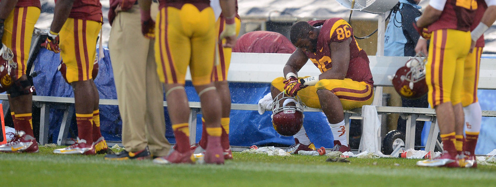 . USC\'s Xavier Grimble #86 hangs his head on the bench during the final seconds of their game against UCLA at the Rose Bowl in Pasadena Saturday, November 17 2012. UCLA beat USC 38-28. (Hans Gutknecht/L.A. Daily News)
