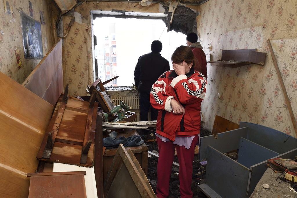 . A woman cries after seeing the damage in her neighbor\'s flat on December 1, 2014 after it was destroyed by shelling during the night in the Telstilshik district of the eastern Ukrainian city of Donetsk. A Ukrainian military spokesman said on November 30 that three Ukrainian soldiers had been killed and 15 wounded in the latest fighting in eastern Ukraine. Fighting was ongoing around Donetsk airport and in Stanitsa Luganska, near rebel-held Lugansk, according to the spokesman, Andriy Lysenko. ERIC FEFERBERG/AFP/Getty Images