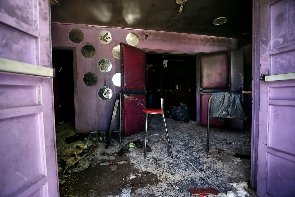 . Partial view at the entrance to the Kiss nightclub where a blaze on the eve killed more than 230 people, on January 28, 2012 in Santa Maria, southern Brazil. Brazilian police arrested four suspects --two of the Kiss club\'s owners, along with a pair of musicians who starred in the ill-fated pyrotechnic show, in the wake of the nightclub fire that forced sports officials to defend preparations for the World Cup and Olympics.    JEFFERSON BERNARDES/AFP/Getty Images