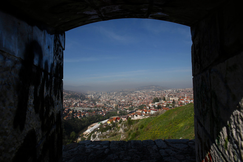 . This Tuesday, April 8, 2014 photo shows a panoramic view of Sarajevo through a window of an old Ottoman fortress. World War I is just one era in the history of this multicultural city, with its legacies of Islamic Ottoman, Jewish, Christian Orthodox and Roman Catholic religions. (AP Photo/Amel Emric)
