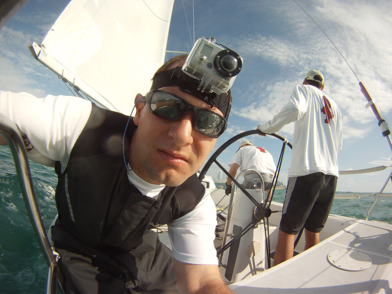 Jon starting the stern camera while wearing a GoPro camera on his head.