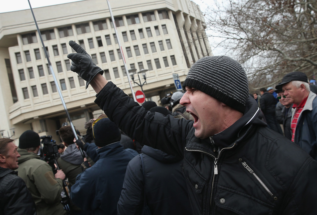 . Pro-Russian supporters rally outside the Crimean parliament building on February 28, 2014 in Simferopol, Ukraine.  (Photo by Sean Gallup/Getty Images)