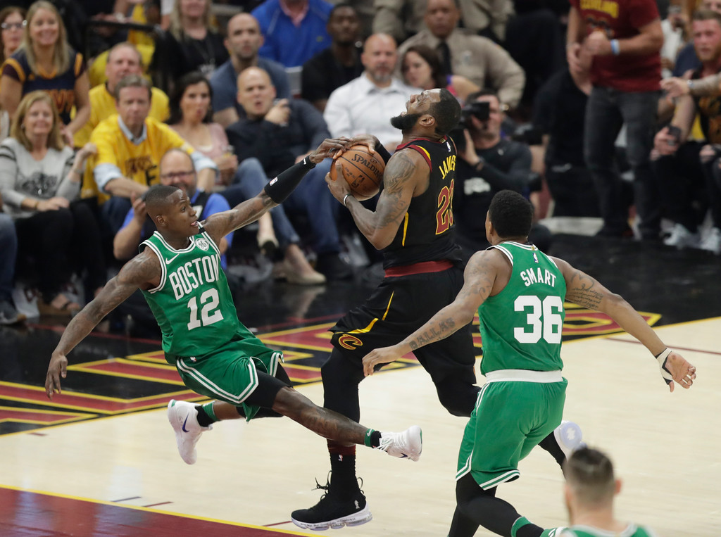 . Cleveland Cavaliers\' LeBron James (23) drives against Boston Celtics\' Terry Rozier (12) as the Celtics\' Marcus Smart follows in the first half of Game 3 of the NBA basketball Eastern Conference finals, Saturday, May 19, 2018, in Cleveland. (AP Photo/Tony Dejak)