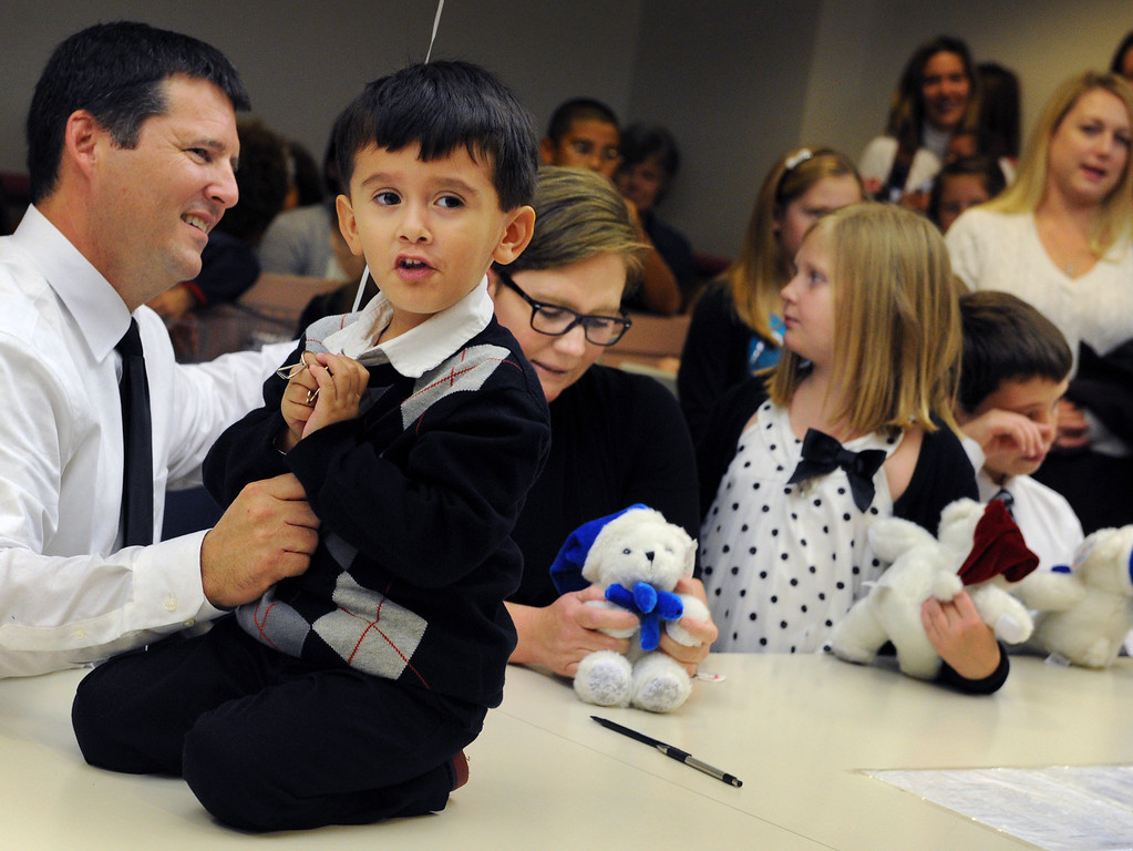 . John Rigsby of La Habra, Angel Rigsby who was adopted, Kerry Rigsby, Anna and Adam Rigsby. On National Adoption Day, hundreds of courts and organizations throughout the nation open their doors to finalize adoptions of children in foster care. Nintey-Five families celebrate with their newly adopted children at the Edmund D. Edelman Children\'s Court in Monterey Park Friday, November 22, 2013.(Photo by Walt Mancini/Los Angeles Daily News)