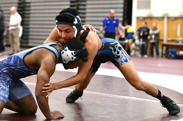 2/22/2020 Mike Orazzi | StaffrBristol Eastern's Aaron Morocho and Middletown's Kalil Shabazz in a 126 match during the Class L State Wrestling Tournament held at Bristol Central High School on Saturday.