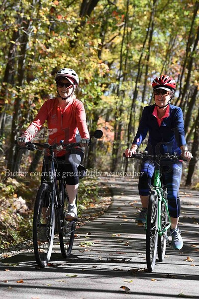 Harold Aughton/Butler Eagle: Clare Torso, retired seneca valley teacher, and Patti Day, a retired nurse, take a ride along the Moraine State Park bike trail, Monday, October 21.