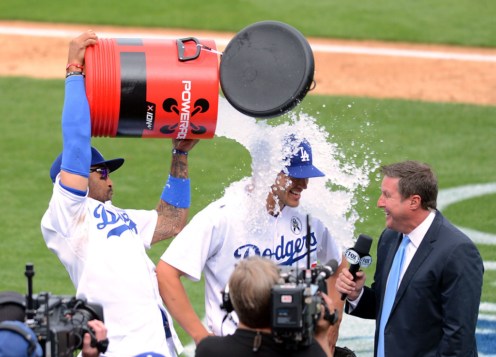. Matt Kemp dumps a bucket of ice water on Clayton Kershaw after his complete game shutout against the Giants on opening day at Dodger Stadium April 1, 2013.  Kershaw also a hit a homerun during the 4-0 victory.(Andy Holzman/Staff Photographer)