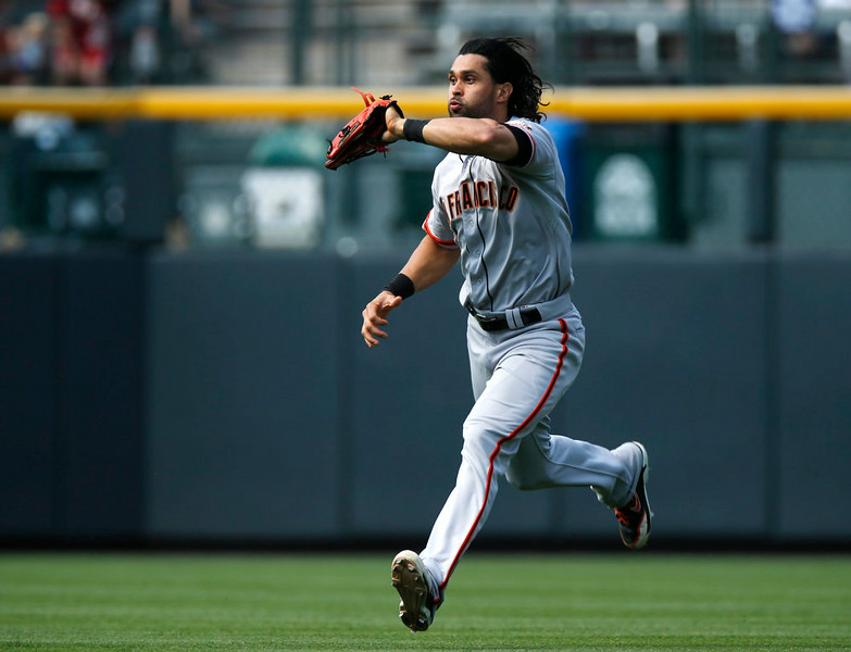 . San Francisco Giants centerfielder Angel Pagan catches fly ball off the bat of Colorado Rockies\' DJ LeMahieu in the eighth inning of the Giants\' 4-2 victory in a baseball game in Denver on Monday, Sept. 1, 2014. The game was resumed in the bottom of the sixth inning of play when it was suspended because of rain on May 22. (AP Photo/David Zalubowski)