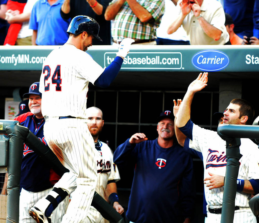 . Minnesota\'s Trevor Plouffe, left, celebrates with Joe Mauer after his twp run homer during the fourth inning. (Pioneer Press: Sherri LaRose-Chiglo)