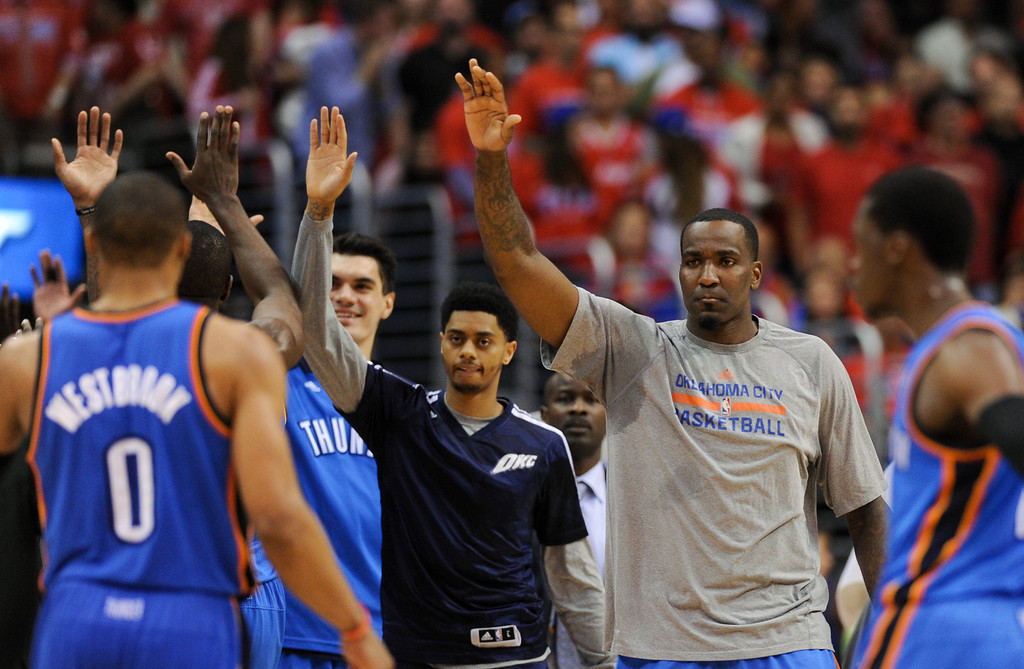 . Thunder celebrate their lead late in the game during a timeout. (Photo by Michael Owen Baker/Los Angeles Daily News)