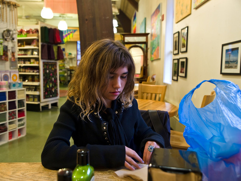 My daughter in Rainbow Foods, our only organic grocery store. September 24, 2009.
