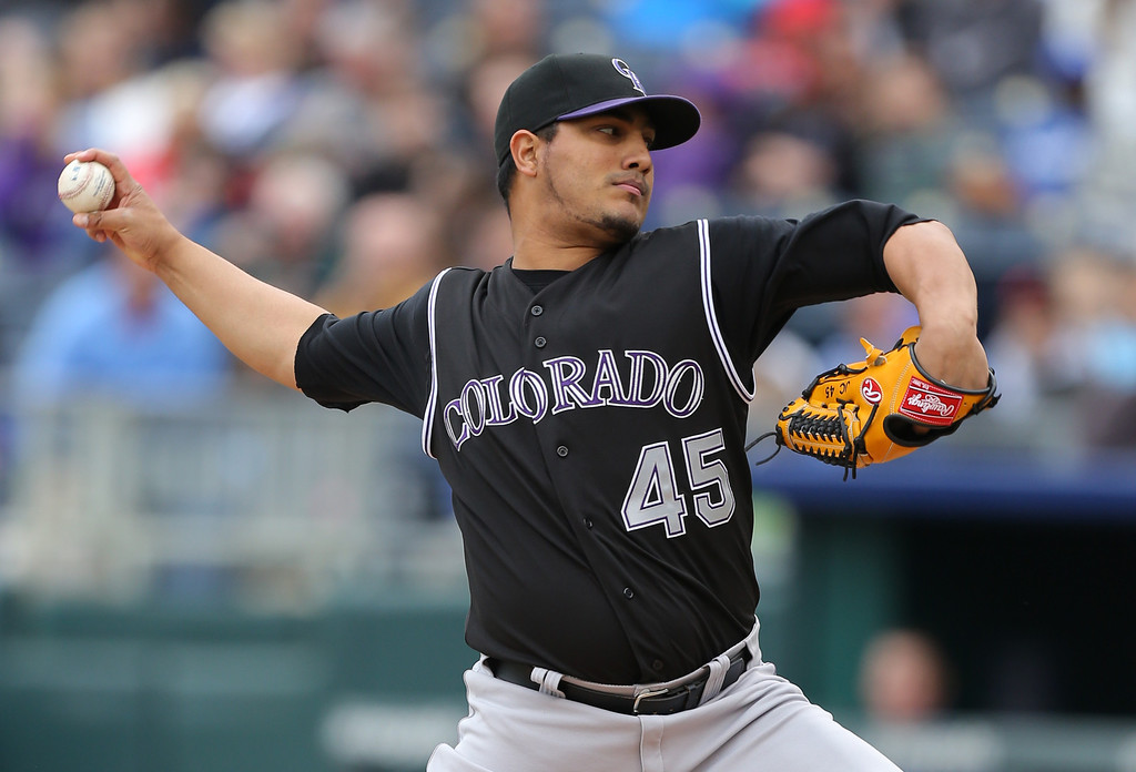 . KANSAS CITY, MO - MAY 14:  Jhoulys Chacin #45 of the Colorado Rockies throws in the first inning against the Kansas City Royals at Kauffman Stadium on May 14, 2014 in Kansas City, Missouri. (Photo by Ed Zurga/Getty Images)